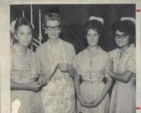 Georgeen DeChow with nursing students ca. 1960s